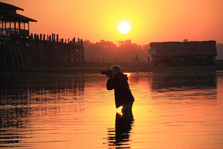 Silhouette of photographer in lake