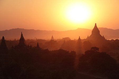 silhouettes of ancient Buddhist Temples after sunset at Bagan, Myanmar