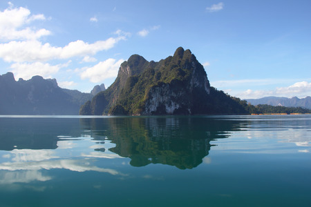 Beautiful reflecting mountain and sky at Khaosok National Park, suratthani, Thailand Stock Photo