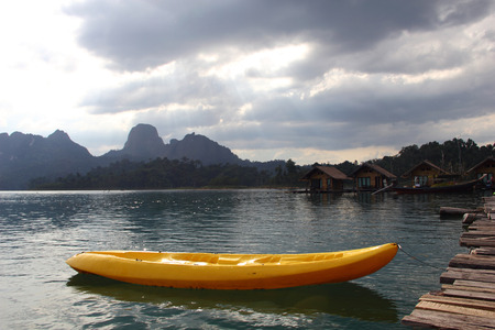 Kayak on Quiet Lake and cloudscape at Khao Sok , suratthani ,thailand