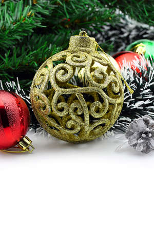 Christmas background with a golden ornament and decorations