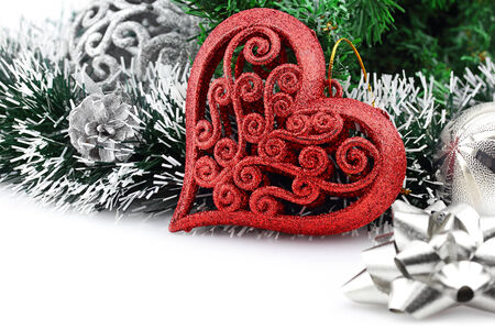 Christmas background with a red heart ornament and decorations Stock Photo
