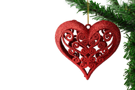 Christmas background with a red heart ornament