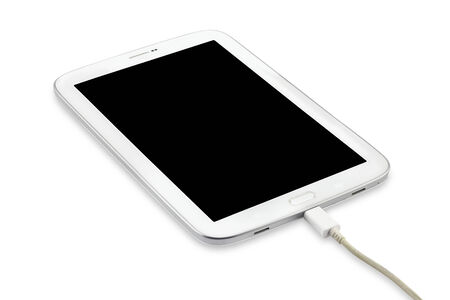 Charging Tablet pc isolated on white background (with clipping path)