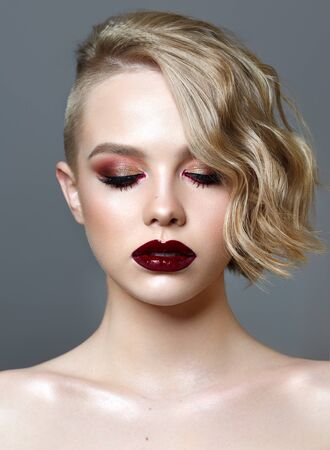 Beautiful girl with the closed eyes, fashion make-up, burgundy wet lips, short hairstyle