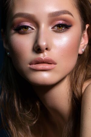 Close up portrait of beautiful young woman with professional makeup, perfect skin, colorful eyeshadows. Banco de Imagens - 132122014