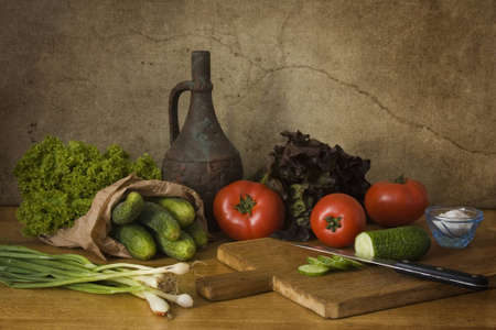 A sill life with vegetables showing preparation for salad photo