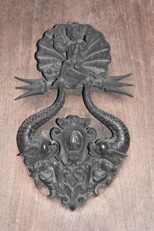 doorhandle: Door-handle in shape of sea theme. Stock Photo
