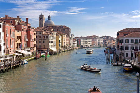 on the canal: Boats float on Venice Grand canal.