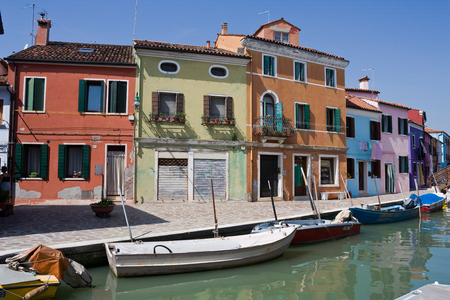 Motorboats moored along the water canal of island Burano in Italy-2