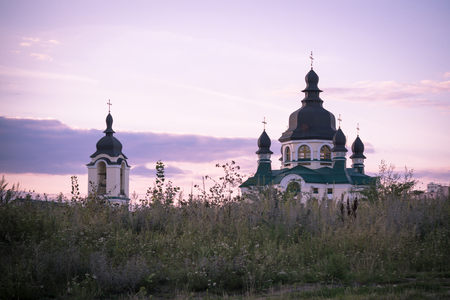 Vishneve, Ukraine-August 19 2012 -Beautiful sunset over the Christian church in the suburbs of Kiev city of Vishneve in Ukraine Banco de Imagens