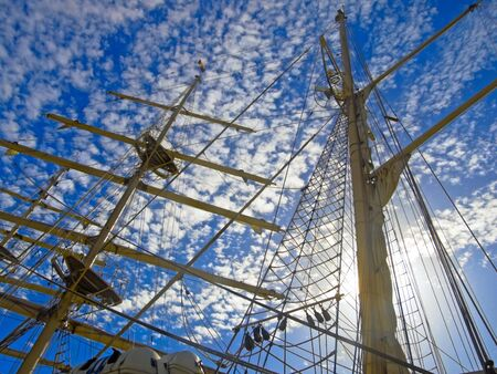 topsail: Masts of Tallship on sky background