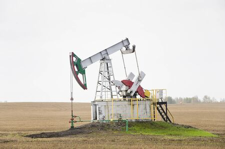 Oil pump on chink in the field Stock Photo