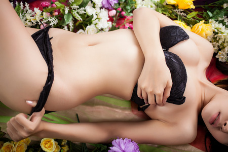naked girl body: Sexy body of woman laying on flowers