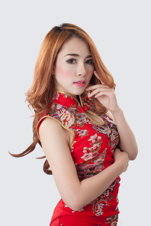 Beautiful Asian model wearing Cheongsam - isolate on white