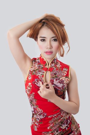 aisa: Beautiful Asian model wearing Cheongsam - isolate on white