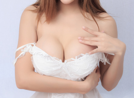 hot breast: Beautiful slim body of woman in studio