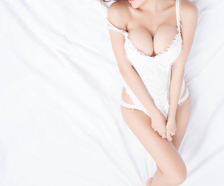 big boobs: Beautiful slim body of woman in studio