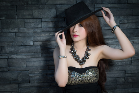 Young beautiful Asian model wearing blackdress Zdjęcie Seryjne