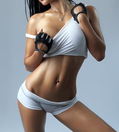 naked woman breasts: Beautiful slim body of woman in studio