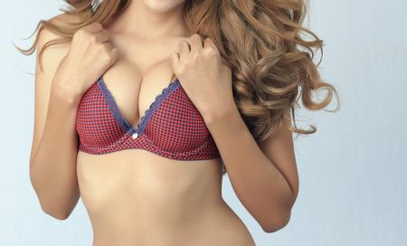 big boobs: Beautiful delgado cuerpo de mujer en estudio Foto de archivo