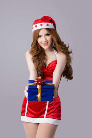 Beautiful asia woman model in Santa Claus clothes - in studio Foto de archivo