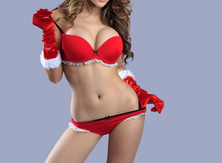 hot breast: Beautiful sexy body of santa woman model - in studio