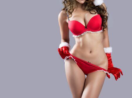 sexy boobs: Beautiful sexy body of santa woman model - in studio