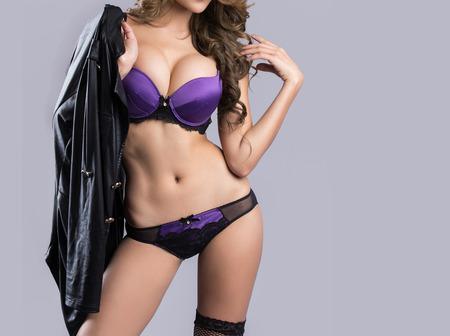 big breast woman: Beautiful slim body of woman in studio