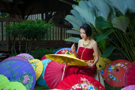 umbella: Thai Woman In Traditional Costume Of Thailand painting umbrella