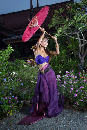 an obeisance: Thai Woman In Traditional Costume Of Thailand Stock Photo