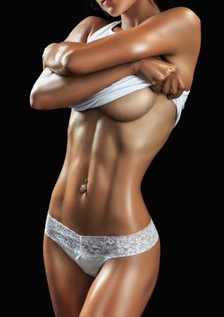 Beautiful female fitness model on black  background