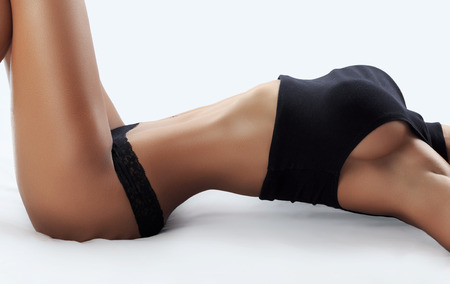 adult breast: Beautiful female fitness model - studio shot