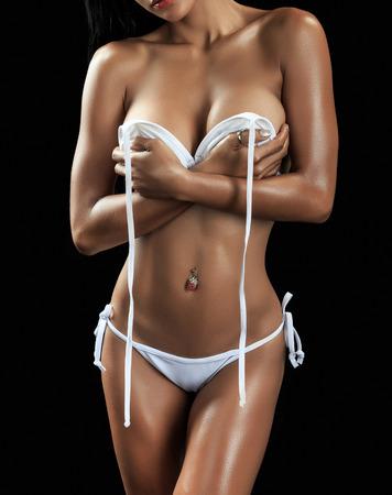 Beautiful female fitness model on black  background