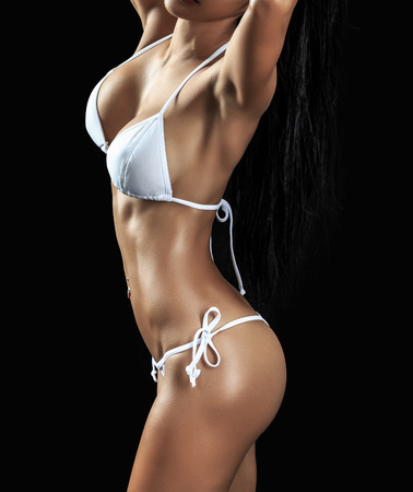hot breast: Beautiful female fitness model on black  background