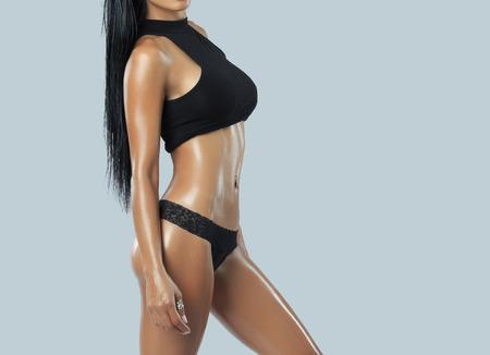 girl boobs: Beautiful female fitness model - studio shot