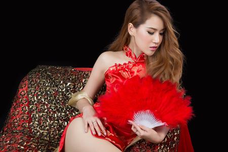 cheongsam: Beautiful Asian model wearing traditional  Cheongsam - studio shot Stock Photo