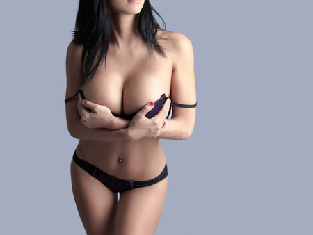 nude breast: Beautiful slim body of woman in studio