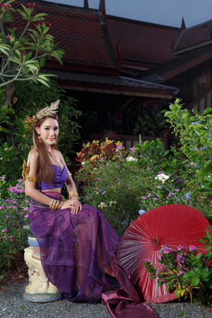politely: Thai Woman In Traditional Costume Of Thailand Stock Photo