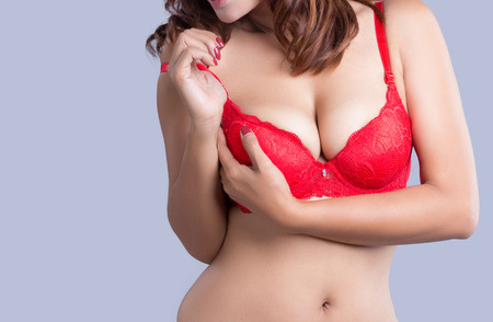 hot breast: Young beautiful sexy Asian woman wearing elegant lingerie - studio shot