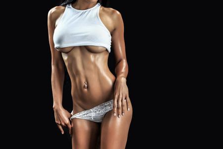 erotic women: Muscular female body - studio shot Stock Photo