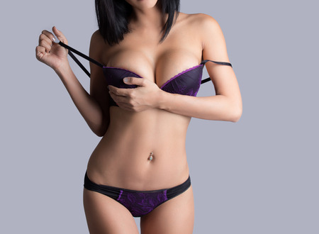 breasts erotic: Beautiful slim body of woman in studio