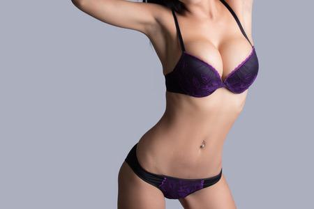 sexual nude: Beautiful slim body of woman in studio