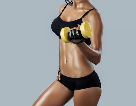 big boobs: Beautiful female fitness model - studio shot