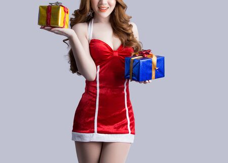 chinese lady: Asian woman model in Santa Claus clothes - in studio Stock Photo