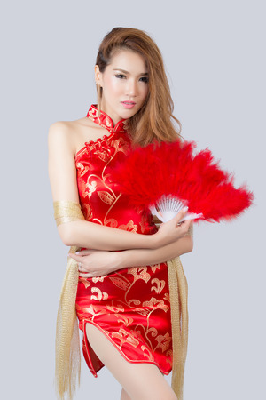 Beautiful Asian model wearing traditional  Cheongsam - studio shot Stock Photo