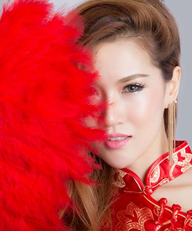 qipao: Beautiful Asian model wearing traditional  Cheongsam - studio shot Stock Photo