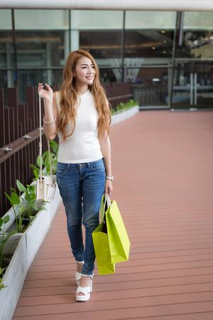 lifestyle shopping: Beautiful young woman with shopping bags
