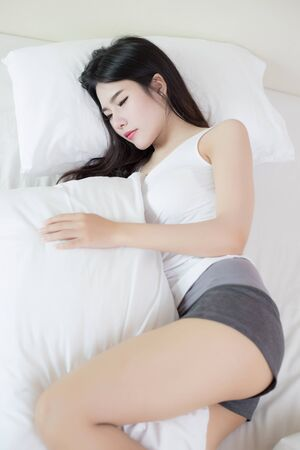 sleep well: young beautiful asian woman sleeping on bed