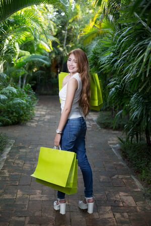 sexy asian woman: Beautiful young woman with shopping bags